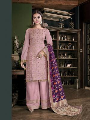 Look Pretty In This Very Beautiful Designer Suit In Baby Pink Color Paired With Contrasting Purple Colored Dupatta. Its Embroidered Top And Bottom are Fabricated On Satin Silk Paired With Jacquard Silk Fabricated Dupatta. Buy This Pretty Piece Now.