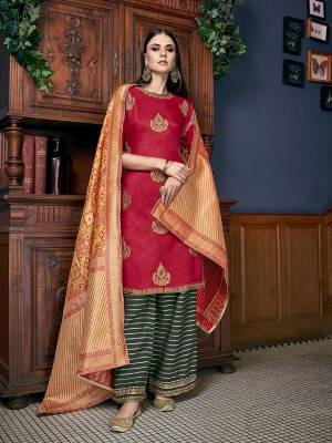 Go Colorful With This Designer Suit In Red Colored Top Paired With Contrasting Pine Green Colored Bottom And Yellow Colored Dupatta. Its Top IS Fabricated On Soft Silk Paired With Jacquard Silk Bottom And Dupatta. Grab This For the Upcoming Festive Season.