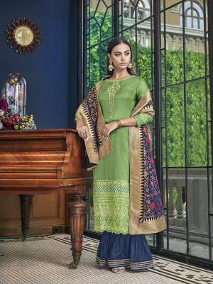 Adorn A Total New Look Wearing This Designer Sharara Suit In Green Colored Top Paired With Contrasting Dark Blue Colored Bottom And Dupatta. Its Top Is Satin Silk Based Paired With Art Silk Bottom And Jacquard Silk Fabricated Dupatta.