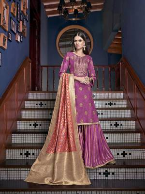 This Festive Season, Have A Beautiful Look Wearing This Designer Sharara Suit In Magenta Pink Color Paired With Multi Colored Dupatta. Its Top Embroidered Is Fabricated On Satin Silk Paired With Jacquard Silk Fabricated Bottom And Dupatta.