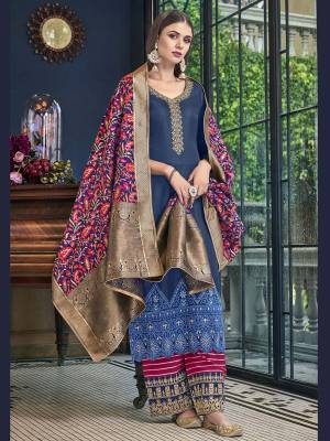 Grab This Beautiful Designer Season Suitable For This Festive Season In Dark Blue Colored Top Paired With Contrasting Magenta Pink Colored Bottom And Multi Colored Dupatta. Its Top Is Satin Silk Based Paired With Jacquard Silk Bottom And Dupatta.