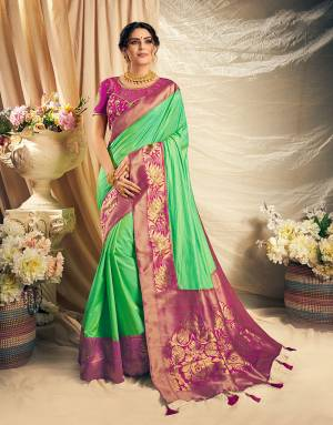 Look conventionally pretty and charming and grace the festivities with a dash of style in this color blocked silk saree.