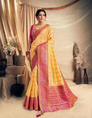 Glow like a morning sun and spread the festival cheer in this stunning yellow and pink saree. Adorn it with beautiful gold jewels to look like sunshine,
