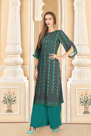 For Your Semi-Casuals, Grab This Designer Readymade Pair Of Kurti And Plazzo In Dark Grey And Teal Blue Color. This Pretty Pair Is Fabricated On Rayon Cotton. Its Pretty Kurti Is Beautified With Digital Prints. Buy Now.