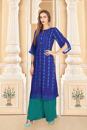 Grab This Beautiful Readymade Pair Of Kurti And Plazzo In Royal Blue And Teal blue Color. This Pair Is Rayon Cotton Based Beautified With Digital Prints Over The Kurti.