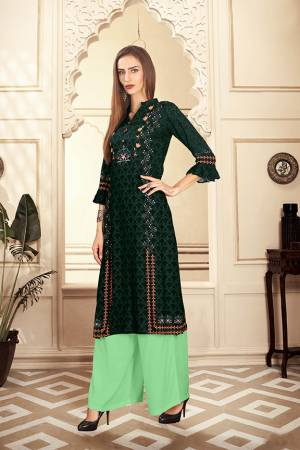 Add This Pretty Pair Of Readymade Kurti And Plazzo To Your Wardrobe In Dark Green And Light Green Color. This Pair Is Fabricated On Rayon Cotton Beautified With Digital Prints.