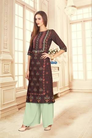 For Your Semi-Casuals, Grab This Designer Readymade Pair Of Kurti And Plazzo In Wine Maroon And Pastel Green Color. This Pretty Pair Is Fabricated On Rayon Cotton. Its Pretty Kurti Is Beautified With Digital Prints. Buy Now.