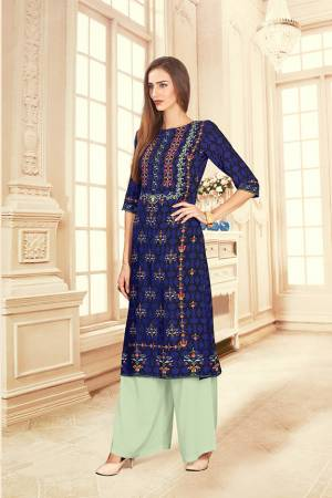Grab This Beautiful Readymade Pair Of Kurti And Plazzo In Royal Blue And Pastel Green Color. This Pair Is Rayon Cotton Based Beautified With Digital Prints Over The Kurti.