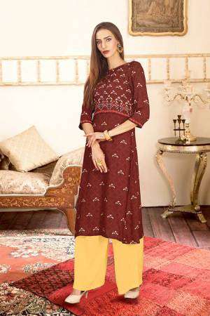 Add This Pretty Pair Of Readymade Kurti And Plazzo To Your Wardrobe In Maroon And Yellow Color. This Pair Is Fabricated On Rayon Cotton Beautified With Digital Prints.