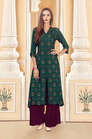 For Your Semi-Casuals, Grab This Designer Readymade Pair Of Kurti And Plazzo In Teal Green And Wine Color. This Pretty Pair Is Fabricated On Rayon Cotton. Its Pretty Kurti Is Beautified With Digital Prints. Buy Now.