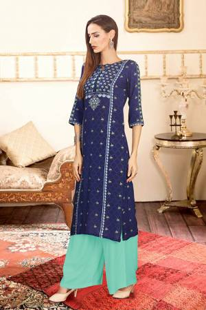 For Your Semi-Casuals, Grab This Designer Readymade Pair Of Kurti And Plazzo In Red And Turquoise Blue Color. This Pretty Pair Is Fabricated On Rayon Cotton. Its Pretty Kurti Is Beautified With Digital Prints. Buy Now.