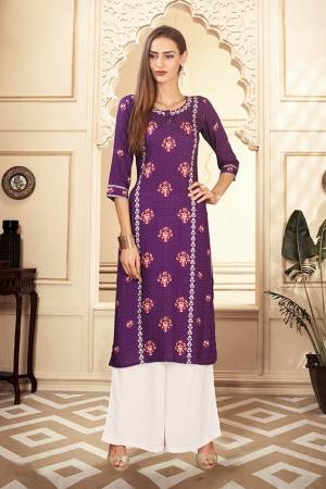 For Your Semi-Casuals, Grab This Designer Readymade Pair Of Kurti And Plazzo In Purple And White Color. This Pretty Pair Is Fabricated On Rayon Cotton. Its Pretty Kurti Is Beautified With Digital Prints. Buy Now.
