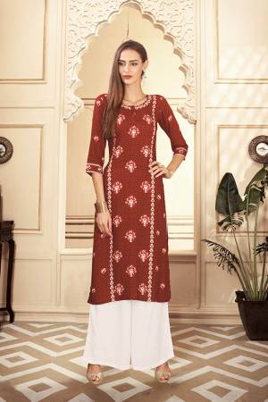 Grab This Beautiful Readymade Pair Of Kurti And Plazzo In Rust Brown And White Color. This Pair Is Rayon Cotton Based Beautified With Digital Prints Over The Kurti.