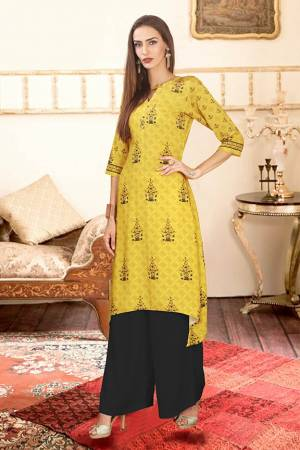 Add This Pretty Pair Of Readymade Kurti And Plazzo To Your Wardrobe In Yellow And Black Color. This Pair Is Fabricated On Rayon Cotton Beautified With Digital Prints.