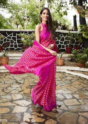 Shine Bright In This Very Pretty Designer Saree In Rani Pink Color Paired With Rani Pink Colored Blouse. This Saree And Blouse Are Fabricated on Kota Brasso Which Is Light Weight And Easy To Carry All Day Long.
