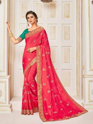Shine Bright Wearing This Designer Silk Based Saree In Dark Pink Color Paired With Contrasting Teal Green Colored Blouse. It Is Beautified With Embroidered Small Butti With Jacqurd Lace Border All Over, Buy Now.
