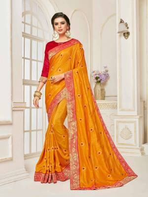 Celebrate This Festive Season Wearing This Designer Silk Based Saree In Musturd Yellow Color Paired With Contrasting Red Colored Blouse. This Saree Is Beautified With Small Embroidered Buttis And Jacquard Lace Border.