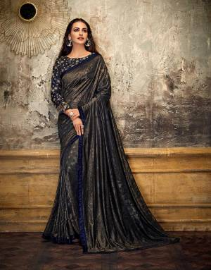 Let this timeless gem of a saree behold multiple eyes in much awe as you sashay around looking glitzy and glamourous. Pair with statement earrings to look our best.