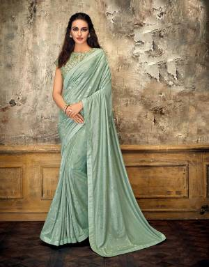 Look flawless in this beautiful Aqua Blue saree with tonal details and ornately embroidered blouse. Go for a stylish nivi drape to look mesmerizing.