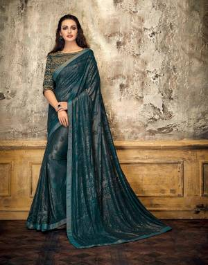 Dive into the spirit of monochromes this fashion season and adorn this Teal Blue monochrom saree-blouse adorned with the perfect touch of gold and look ethereal.