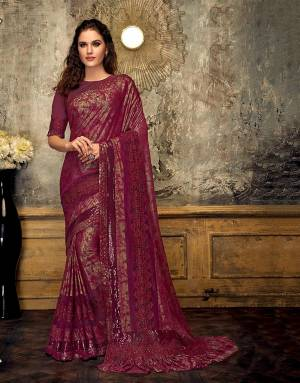 Give your ethnic wear romance a touch of glitter and glam in this stylish and modern saree. Pair with beautiful rubies and look regal.