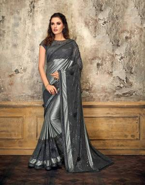 Let your sartorial choices speak volumes in this noteworthy grey glittery saree. Adorn it with delicate diamond jewels and look enchanting.