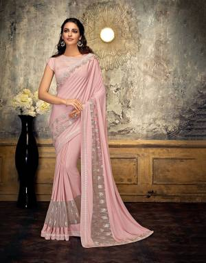 Style and substance will be yours in this subtle, romantic Baby Pink saree embellished with delicate beads and flower appliques.  Pair with delicate jewels to appear pretty.