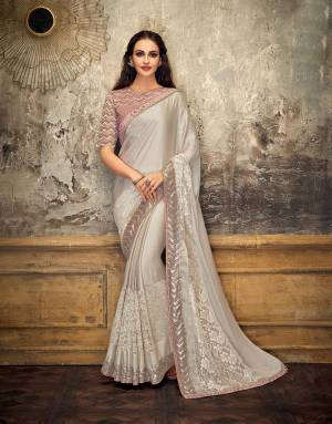 Define a dazzling stature to an otherwise subtle appearance in this perfectly stylized saree . Opt for a free-falling drape to make the most out of this beauty.