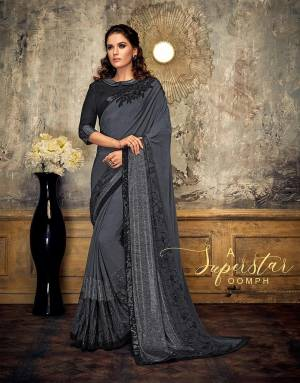 Ooze a superstar-like oomph in this very basic yet outstanding black and grey saree. Pair with statement studs and be the talk of the town,