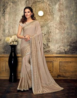 Exude an effortless allure in this delicate beige saree with equally delicate print. Opt for rose gold jewels to make a perfect pair.