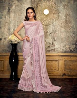Tell the tale of glamour and class in this stylish and frilly saree and attract just the right amount of attention. Drape the pallu in half-falling style for a perfect look.