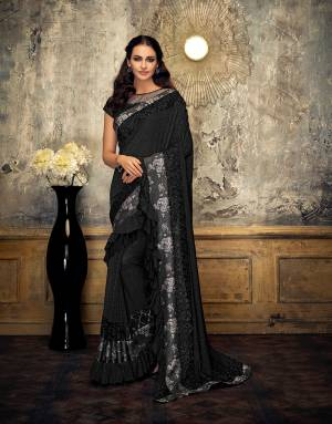 It's never too difficult to look like a bollywood diva. Opt for this extremely stylish and sassy black saree and appear like a celebrity .