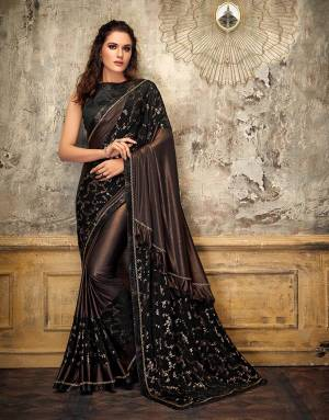 Go all bold and beautiful in this copper-ish saree and give your festive appearances a red-carpet look. Let the pallu fall free to flaunt that frill.