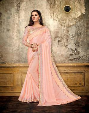 Look sensational and glorify your look this season in this very trendy Peach saree with 3d details and embellishments. Opt for subtle jewels to complete the look.