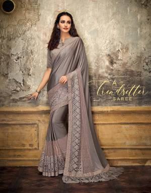 Set a trend and blaze a trail in this gorgeous and classic saree with beautiful embellishments. Add bold studs to complete the look.