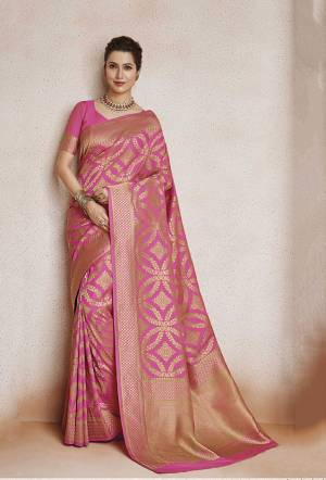 Look Pretty In This Designer Silk Based Saree In Pink Color. This Pretty And Blouse Are Soft Art Silk Based Beautified With Weave. Buy This Saree Now.