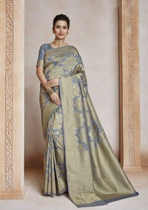 Celebrate This Festive Season In Traditional Look Wearing This Designer Saree In Grey Color . This Saree And Blouse Are Fabricated On Soft Art Silk Beautified With Weave All Over. It Is Light Weight, Durable And Easy To Carry All Day Long.