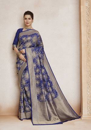 Enhance Your Personality Wearing This Designer Silk Based Saree In Blue Color. This Saree And Blouse Are Fabricated On Soft Art Silk Beautified With Weave All Over.