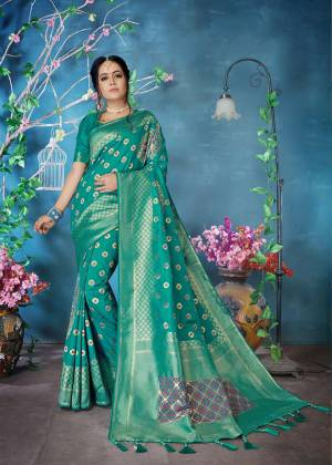 Add This Very Pretty Designer Silk Based Saree In Sea Green Color Paired With Sea Green Colored Blouse. This Saree And Blouse Are Fabricated On Banarasi Art Silk Beautified With Weave All Over It.
