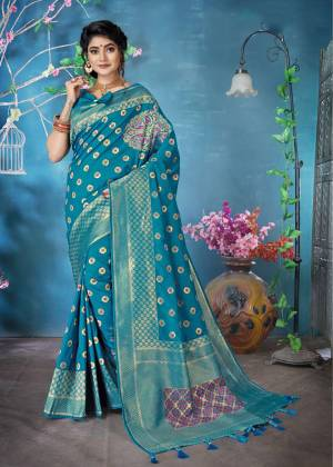 Grab This Pretty Silk Based Saree For The Upcoming Festive Season Wearing This Designer Saree In Blue Color Paired With Blue Colored Blouse. This Saree And Blouse Are Fabricated On Banarasi Art Silk Beautified With Weave All Over It, Buy Now.