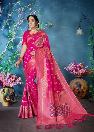 Shine Bright Wearing This Designer Silk Based Saree In Dark Pink Color Paired With Dark Pink Colored Blouse. This Saree And Blouse are Fabricated On Banarasi Art Silk Beautified With Weave.