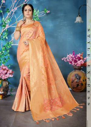 Must Have Shade In Every Womens Wardrobe Is Here With This Lovely Peach Colored Saree Paired With peach Colored Blouse. This Saree And Blouse Are Fabricated On Banarasi Art Silk Beautified With Weave All Over.