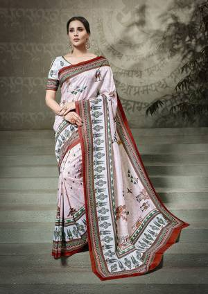 Simple And Elegant Looking Printed Saree Is Here In Baby Pink Color Paired With Off-White Colored Blouse. This Saree And Blouse Fabricated On Tussar Art Silk Beautified With Digital Prints All Over.