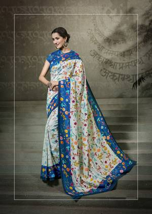 Go Colorful With This Multi Colored Saree Paired With Blue Colored Blouse. This Saree And Blouse Are Fabricated On Tussar Art Silk Beautified With Digital Prints All Over It.
