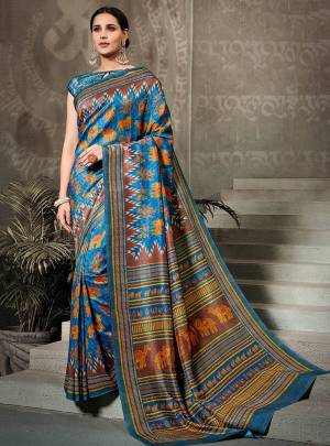 This Festive Season, Go Traditional Wearing This Printed Saree In Blue Color Paired With Blue Colored Blouse. This Saree And Blouse Are Fabricated On Tussar Art Silk Beautified With Digital Prints All over. Buy Now.