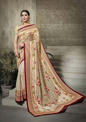 Go Traditional With This Cream Colored Saree Paired With Cream Colored Blouse. This Saree And Blouse Are Fabricated On Tussar Art Silk Beautified With Digital Prints All Over It.