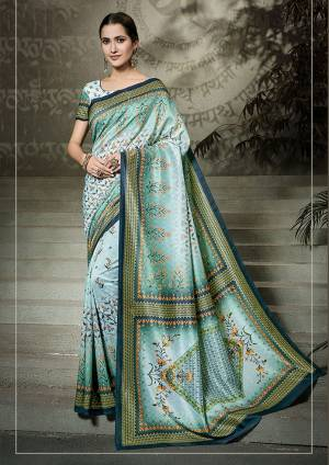 This Festive Season, Go Traditional Wearing This Printed Saree In Sly Blue Color Paired With Sky Blue Colored Blouse. This Saree And Blouse Are Fabricated On Tussar Art Silk Beautified With Digital Prints All over. Buy Now.