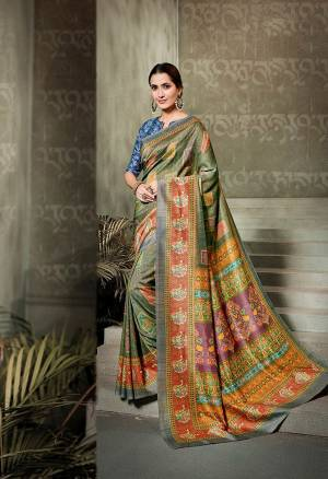 Enhance Your Personality With This Bold And Beautiful Designer Saree In Green And Multi Color Paired With Blue Colored Blouse. This Saree And Blouse Are Fabricated On Tussar Art Silk Beautified With Digital Prints All Over.