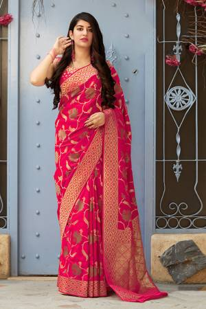 Celebrate This Festive Season With Beauty And Comfort In This Elegant Looking Designer Silk Based Saree In Rani Pink Color. This Saree And Blouse Are Fabricated On Banarasi Art Silk Beautified With Small Butti Weave All Over. Buy Now.?
