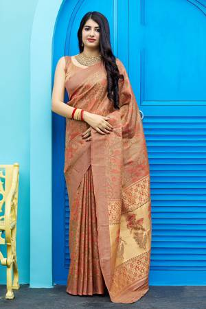 Celebrate This Festive Season With Beauty And Comfort In This Elegant Looking Designer Silk Based Saree In Light Brown Color. This Saree And Blouse Are Fabricated On Art Silk Beautified With Small Butti Weave All Over. Buy Now.?
